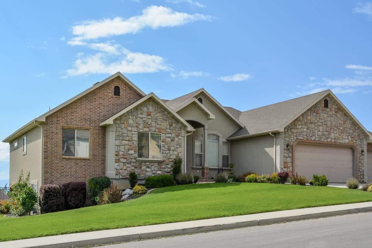 An alternate exterior showcasing a combination of stone, brick, and stucco siding.