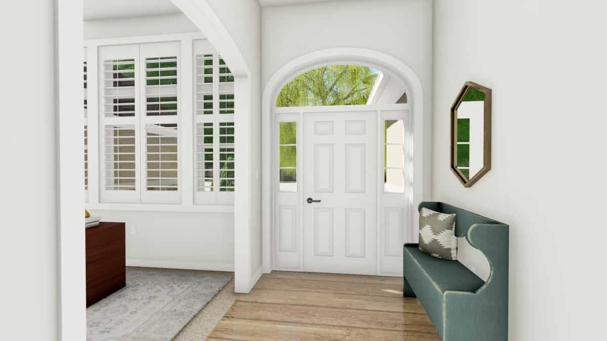 Foyer with a wingback bench, a hexagonal mirror, and a white entry door topped with an arched transom.