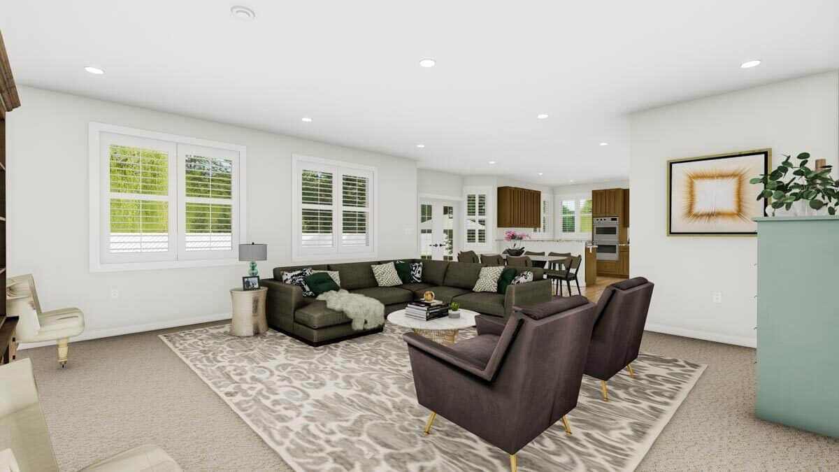 Family room with modern seats and a round coffee table sitting on a patterned area rug.