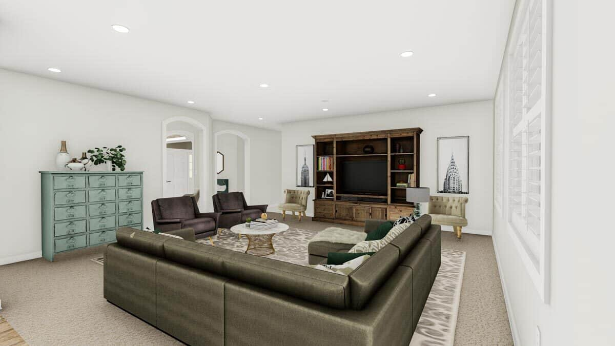 The family room is brightened by recessed ceiling lights along with natural light coming from the louvered windows.