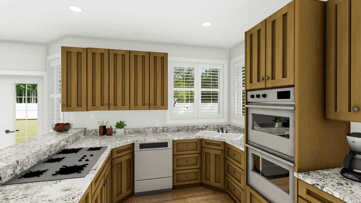 The peninsula is fitted with a built-in cooktop while a double bowl sink sits under the louvered windows.