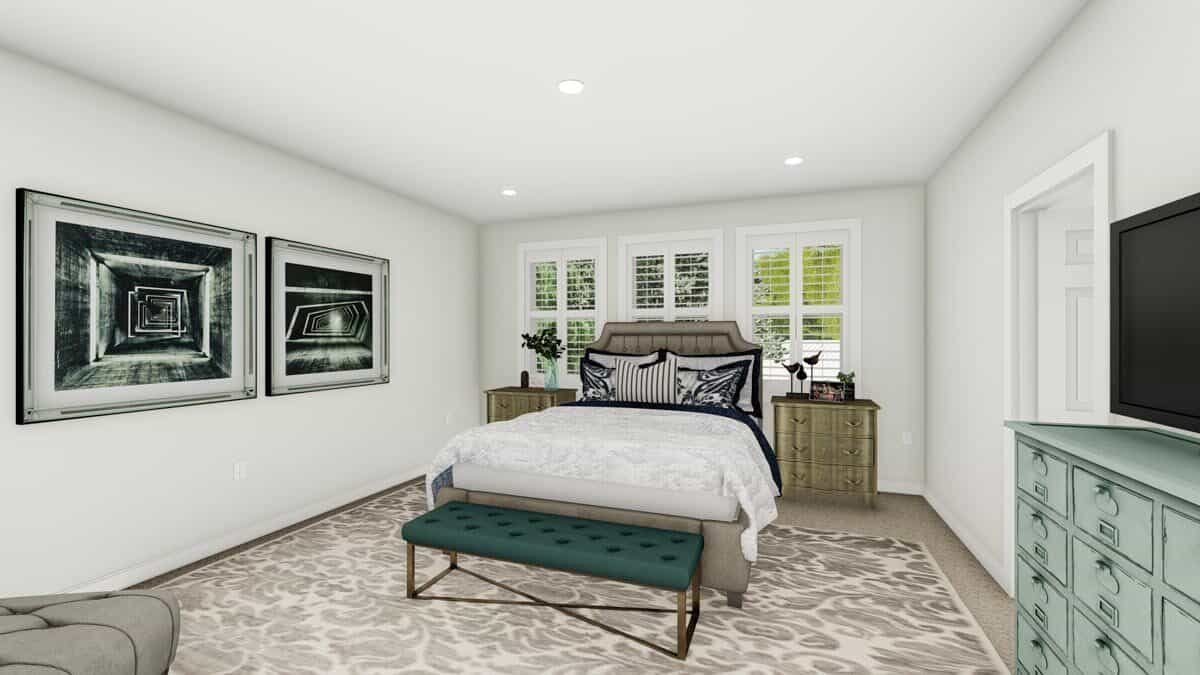 Primary bedroom with large artworks, matching nightstands, and an upholstered bed with a tufted bench at its end.