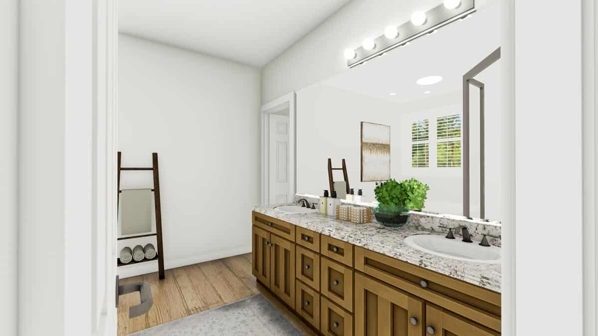 The primary bathroom features a dual sink vanity paired with a large frameless mirror.
