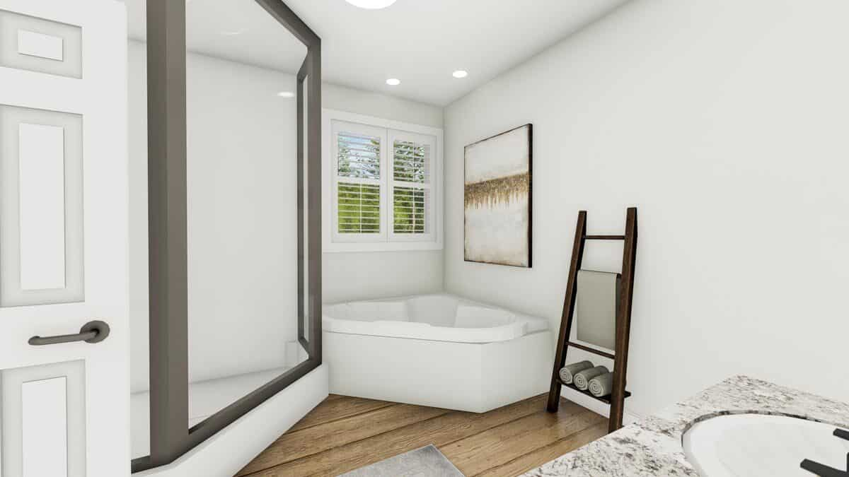 An abstract painting along with a wooden towel rack complements the corner bathtub.