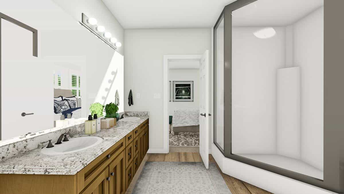 A walk-in shower sitting across the vanity completes the primary bathroom.