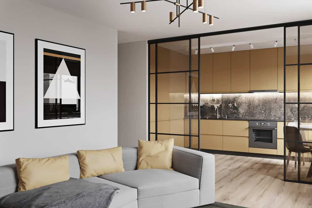 This is a close look at the light gray cushioned sofa of the living room that pairs well with the light grayish beige tone of the walls and ceiling.