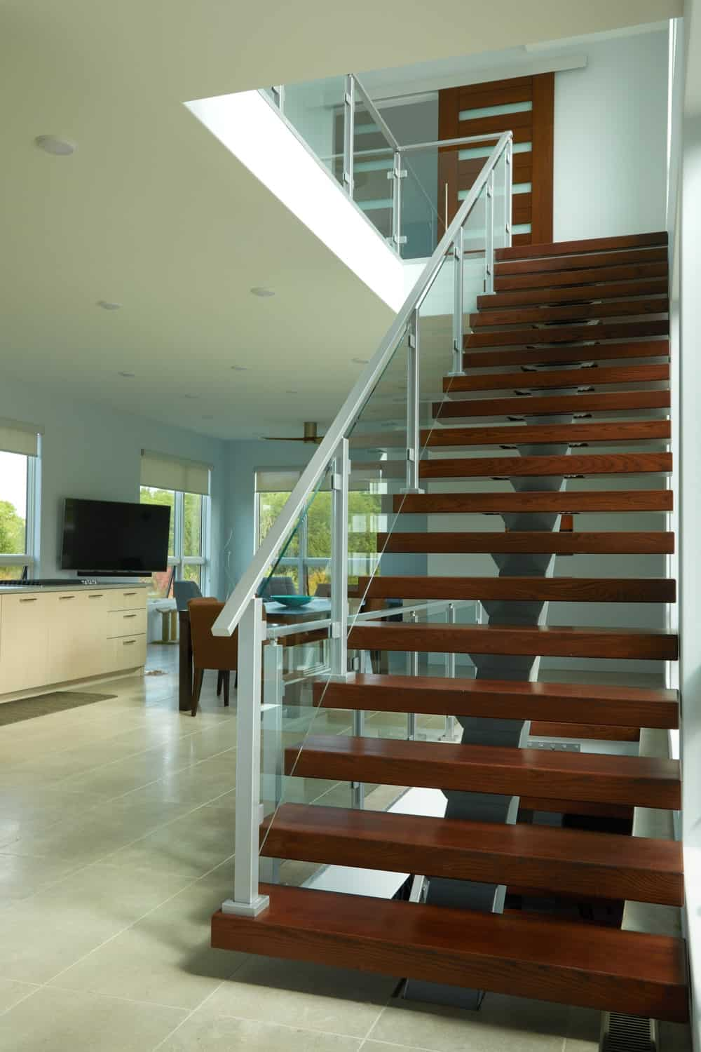 This is a closer look at the banisters of the staircase that also has a modern touch to it.