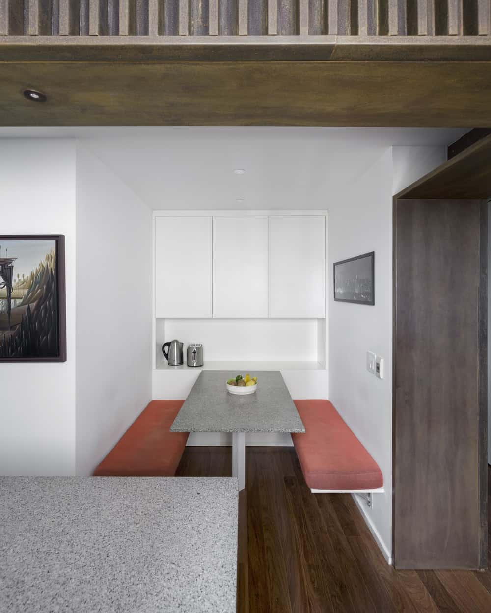On the side of this kitchen is a booth-style breakfast nook with built-in table and benches.