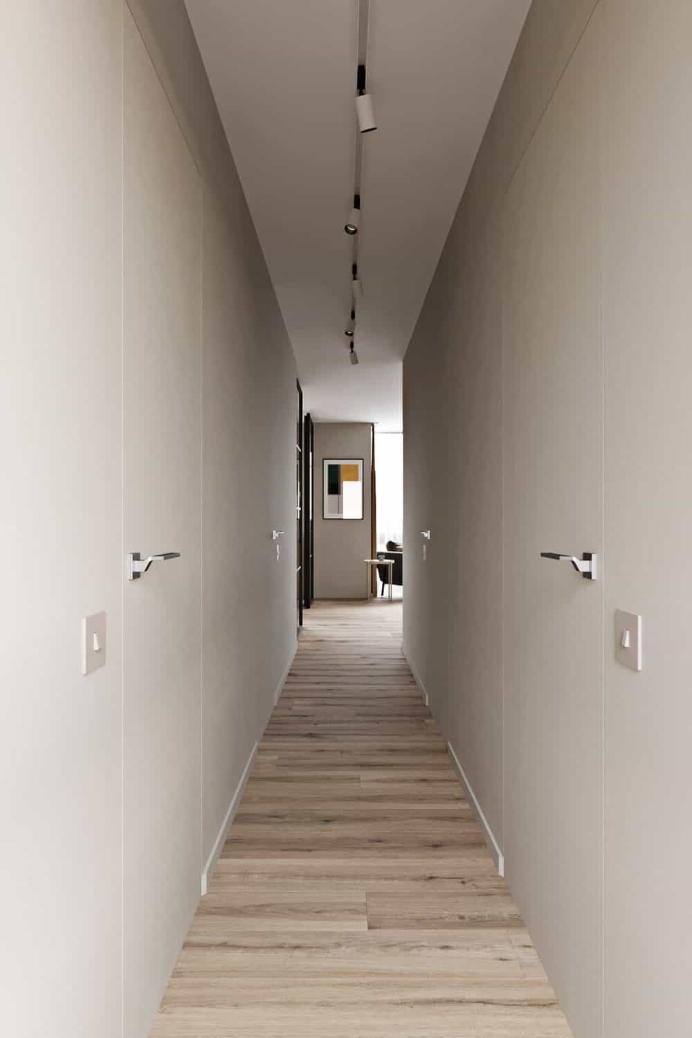This is long and narrow hallway with a light hardwood flooring complemented by the light beige walls that blends well with the doors.