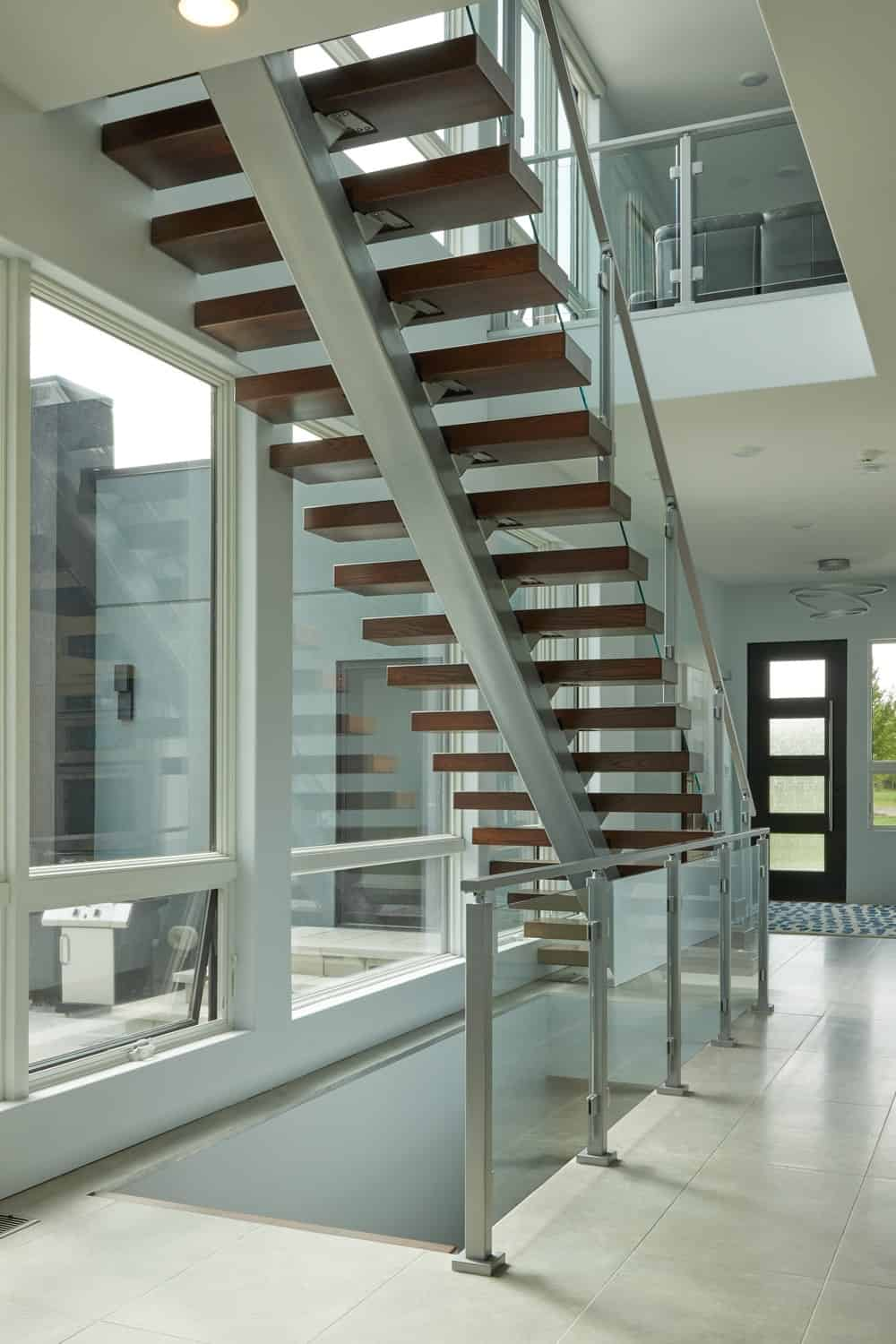 A look underneath the staircase showcases the large metal bar that serves as a support for the steps.