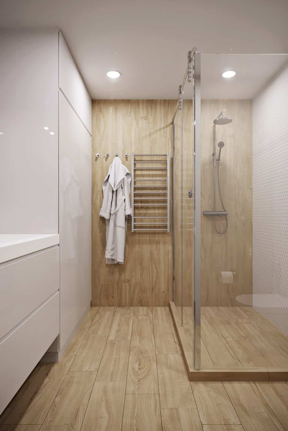 This is the bathroom that has a modern bright beige floating vanity and a glass-enclosed shower area.