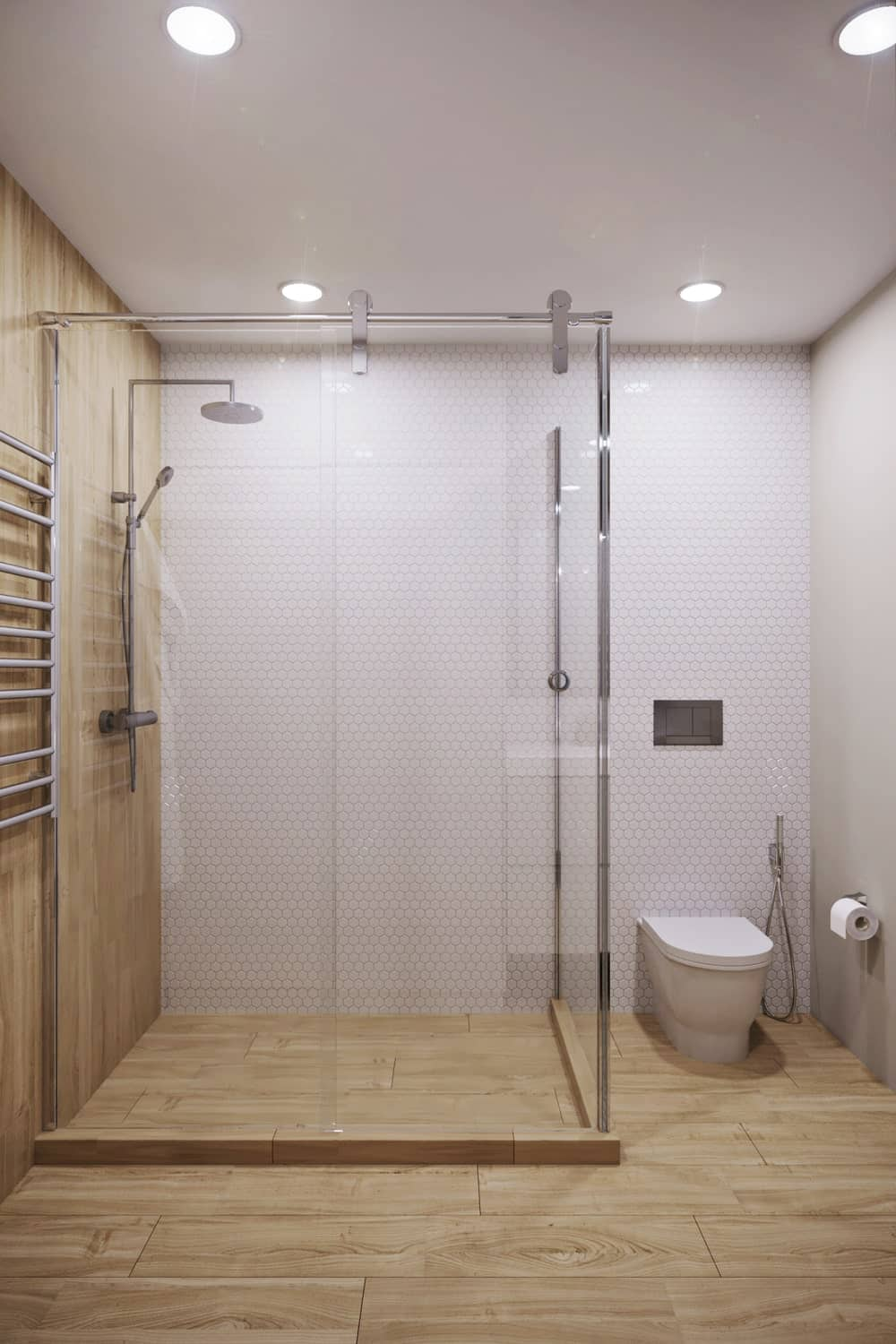 This view of the bathroom showcases more of the glass-enclosed shower area and the toilet beside it within its own alcove.