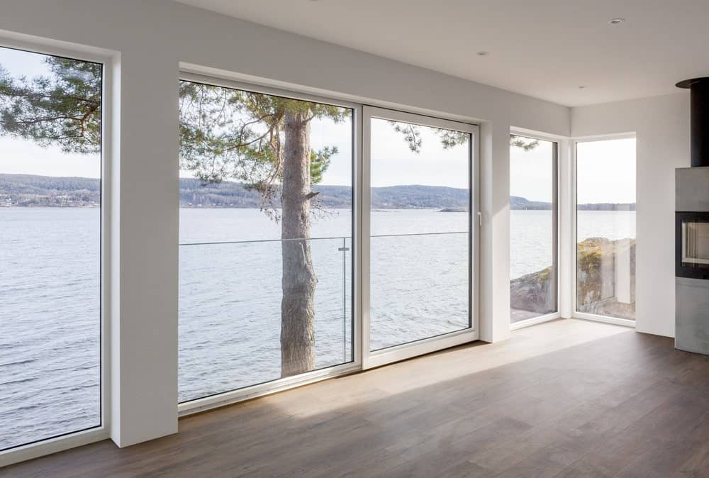 This is a look at the interior of the jouse with large glass wall that maximize the view of the water scenery outside.
