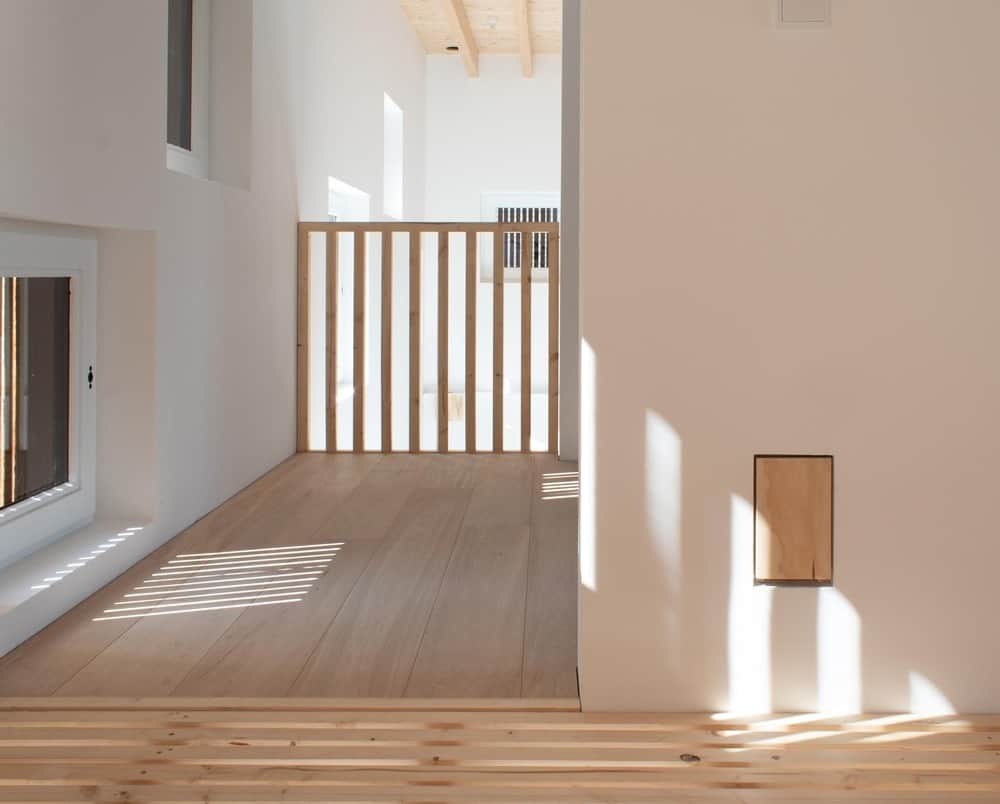 This is a look at the second floor hallway with complementing tones of beige and light wood.