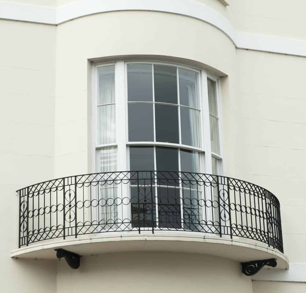 This is a close look at a higher level bow window with balcony.