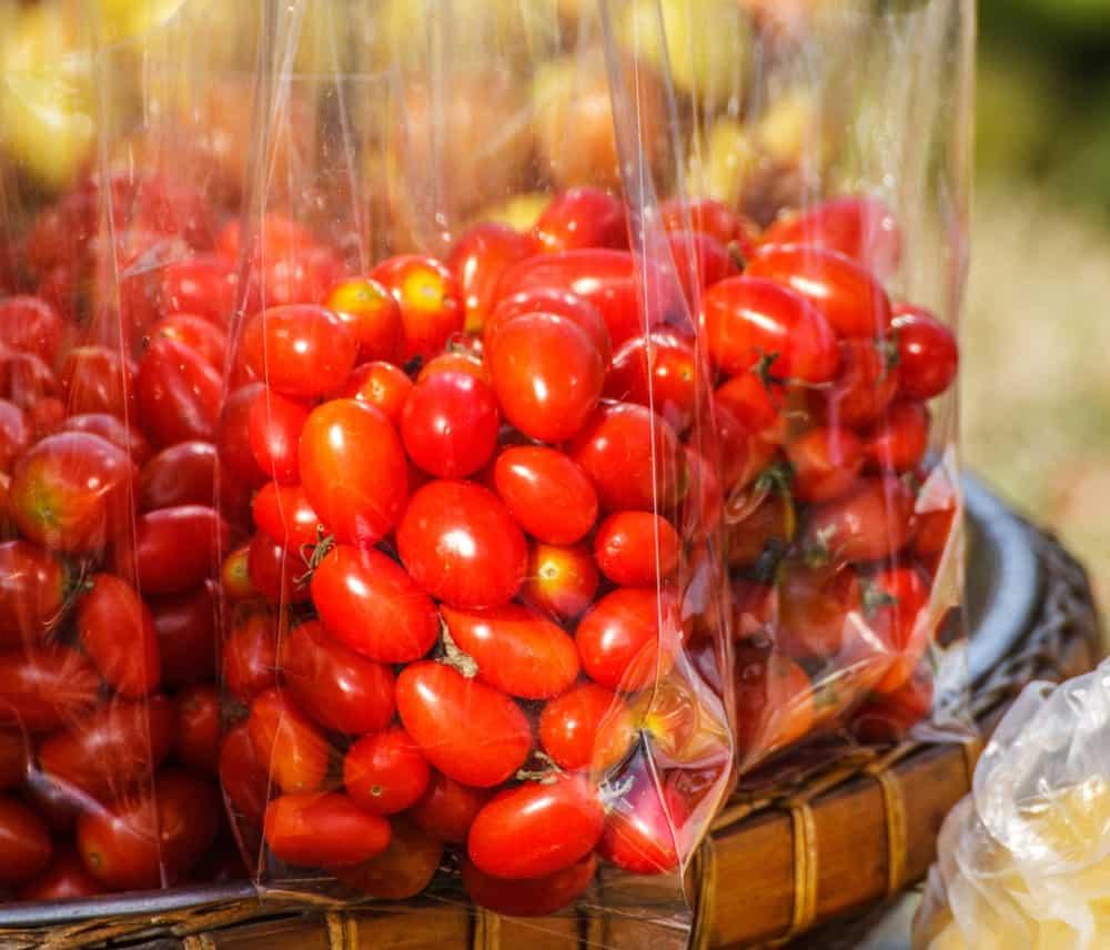Plastic bags of organic ripe tomatoes.