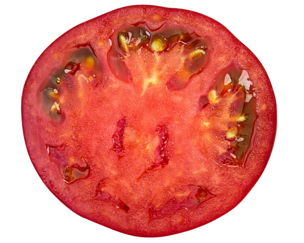 A close look at a halved tomato.
