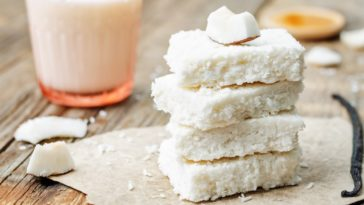 A stack of coconut butter bars on a rustic setup.