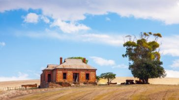 A brick house and farm perfect for a homesteading lifestyle.