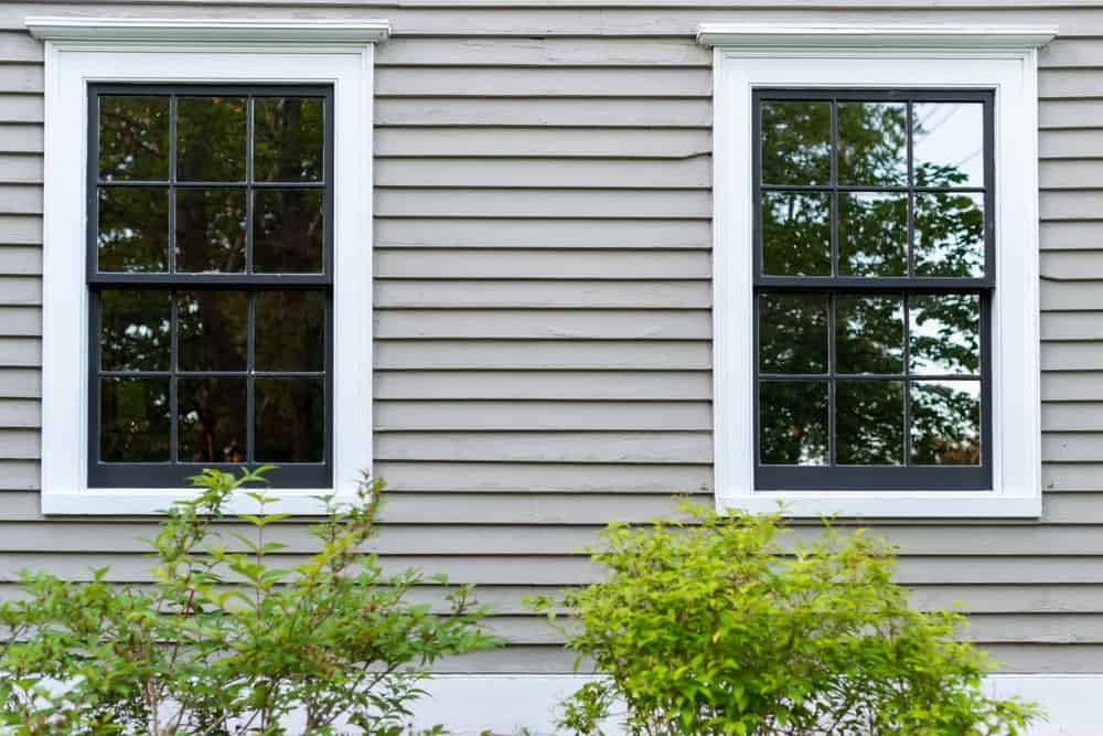 This is a close look at a home with double hung windows.