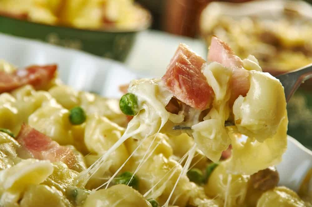 A close look at cheesy baked tortellini with bacon.