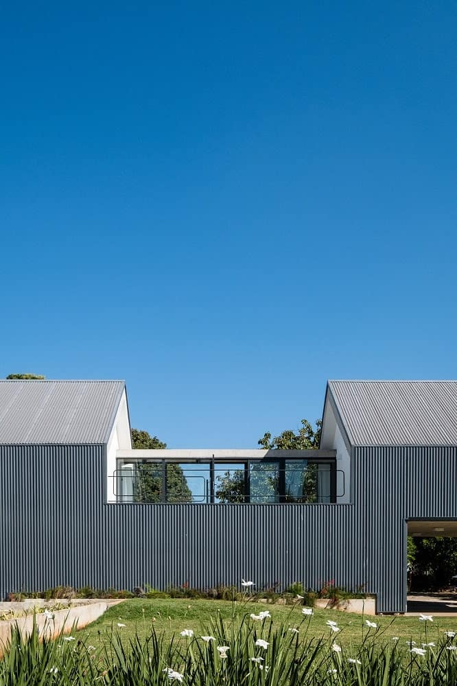 This is a farther look at the rooftop level of the house and the section that has glass walls to let natural light in.