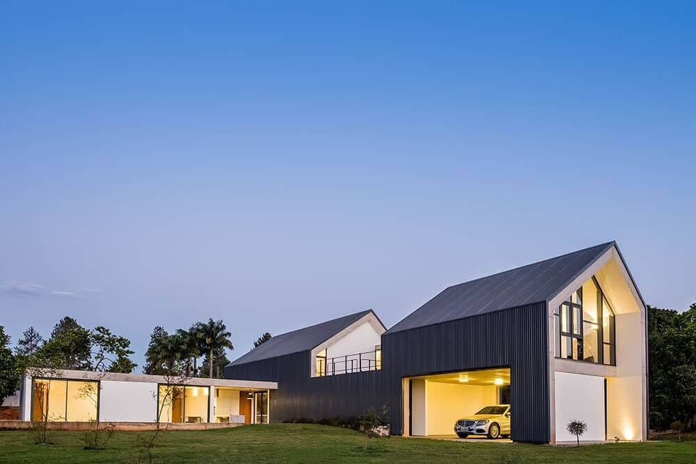 This side of the house showcases the large garage with a large opening wall that can fit two cars.