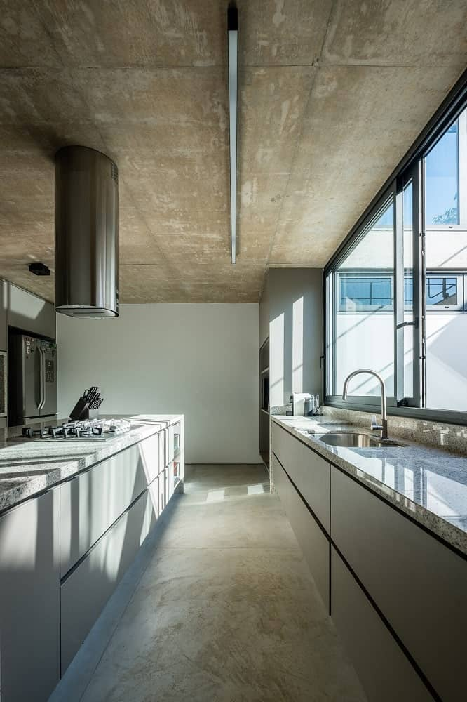 This is the long and narrow kitchen with modern cabinetry and an industrial-style feel to its appliances.