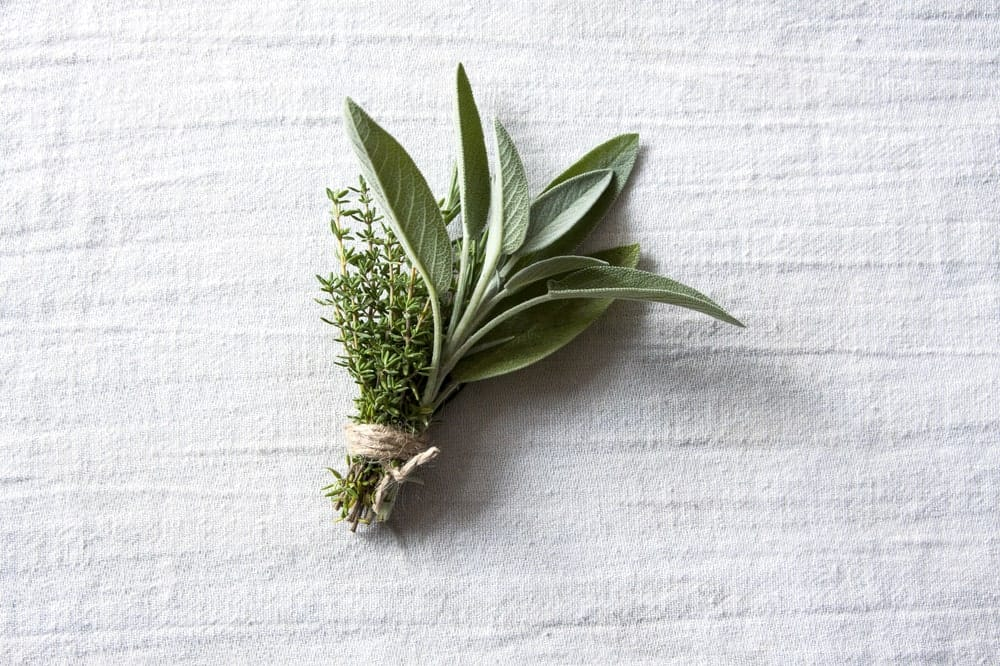A cluster of sage on a table.
