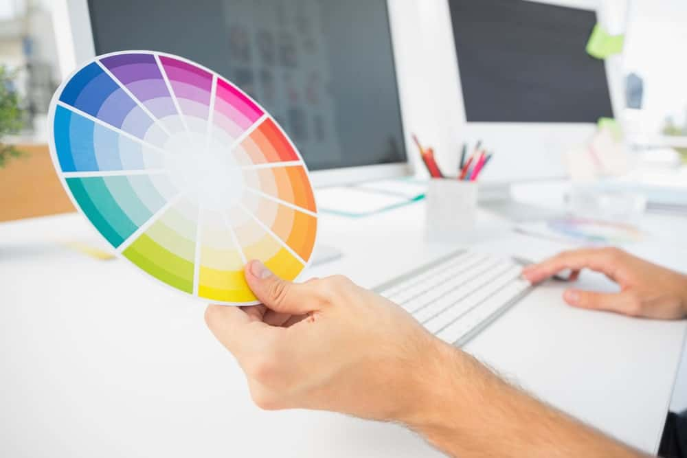 A person looking at a color wheel.