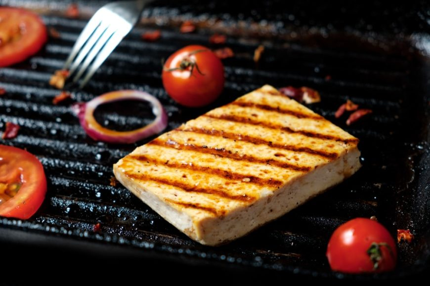 A close look at a piece of grilled tofu.