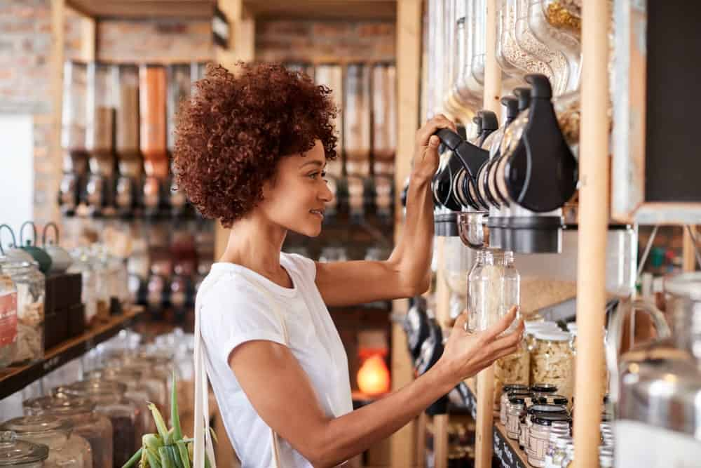 A woman buying her grains in a plastic-free store.