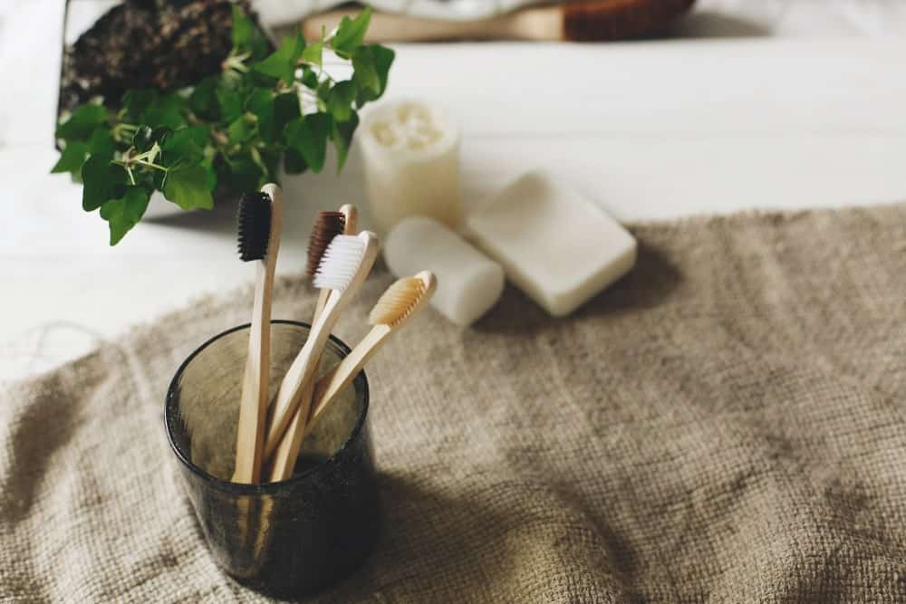 Bamboo toothbrushes on a rustic eco-friendly setup.