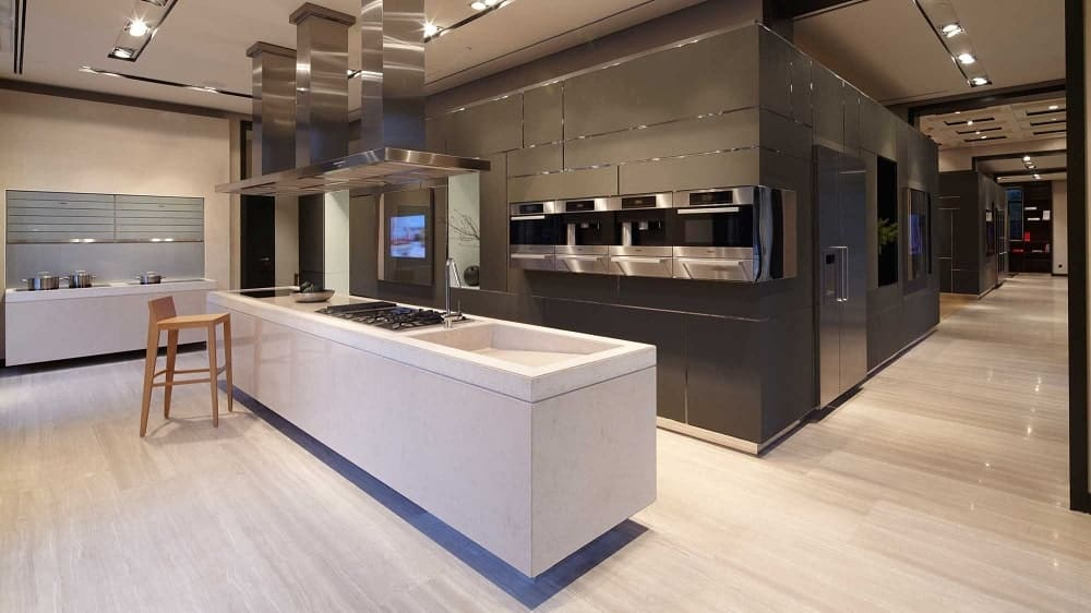 This is a look at the modern kitchen with black and white tones complemented by the stainless steel elements.