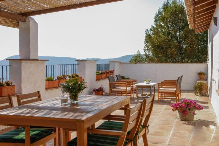 This is the spacious balcony on the upper floor of the house with another covered area fitted with an outdoor dining set.