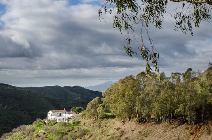 This is an aerial view of the house showcasing the surrounding landscape and mountain views.