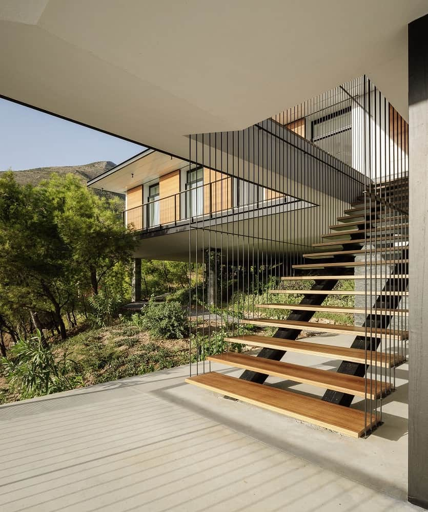 This is a close look at the floating staircase of the terrace that leads up to the balcony above.