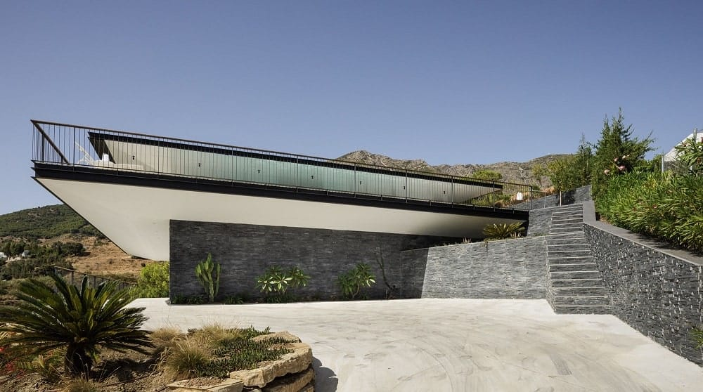 This is a closer look at the textured mosaic stone walls that support and complement the house.