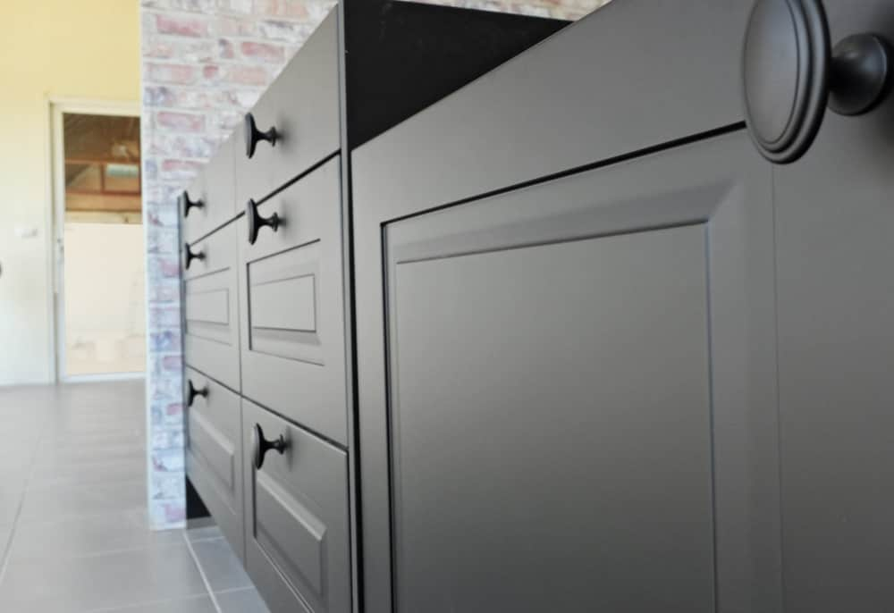 A close look at kitchen cabinetry with matte paint.