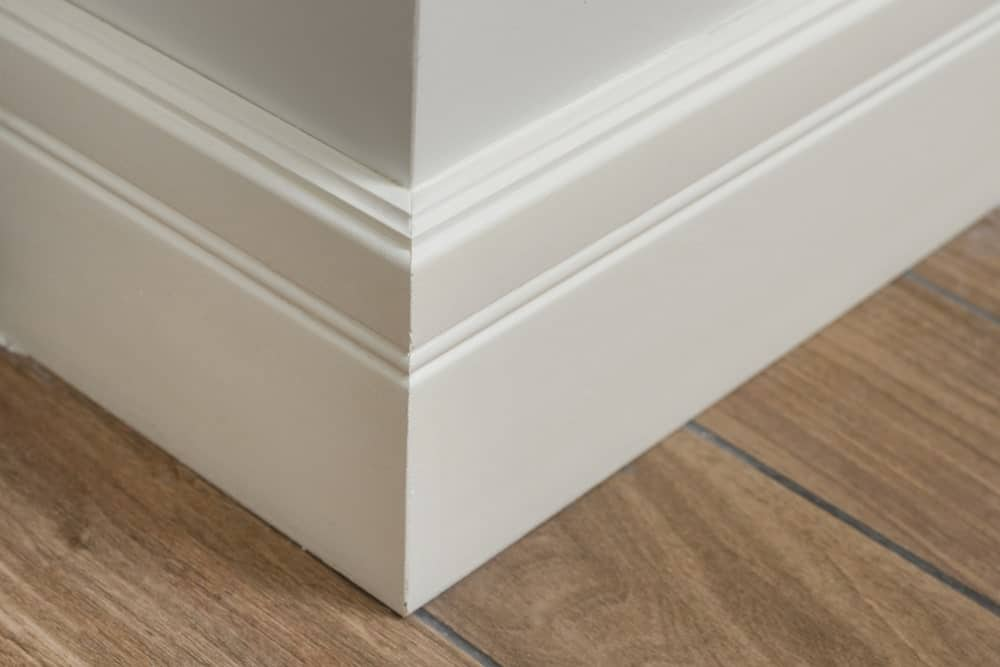 This is a close look at a corner of a house with white matte molding.