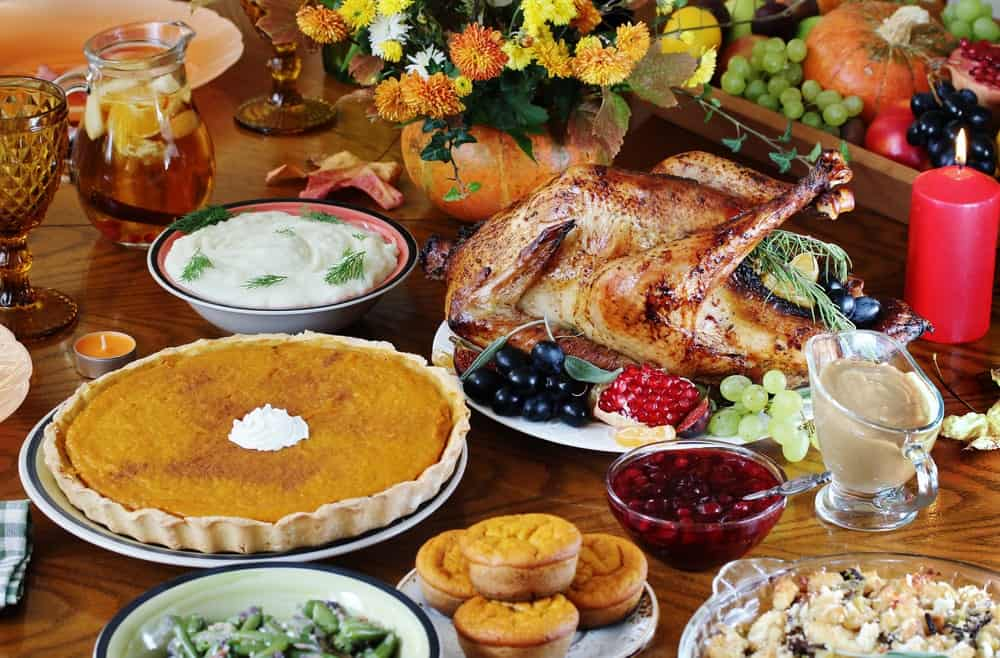 A picturesque Thanksgiving spread with pumpkin pie.