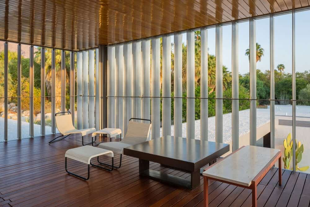 This is a sitting area that has a view of the surrounding landscape and bathed in natural lighting. Image courtesy of Toptenrealestatedeals.com.