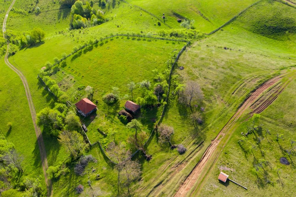 This is an aerial view of a rural farm residency that is perfect for homesteading.