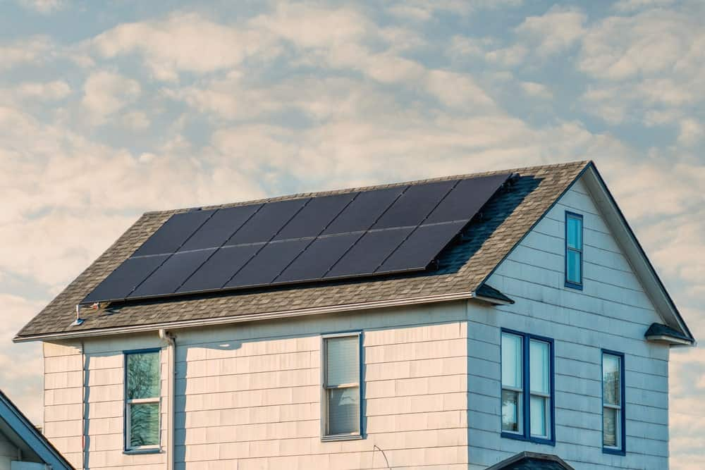 This is a close look at a house with large solar panels.