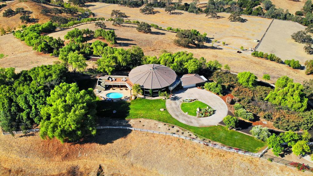 This is the aerial view of the Founder's Building showcasing the circular driveway and the pool area. Image courtesy of Toptenrealestatedeals.com.