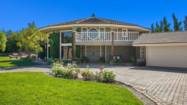 This is a look at the front of the Founder's building inside the ranch with a large front lawn and a wide driveway. Image courtesy of Toptenrealestatedeals.com.