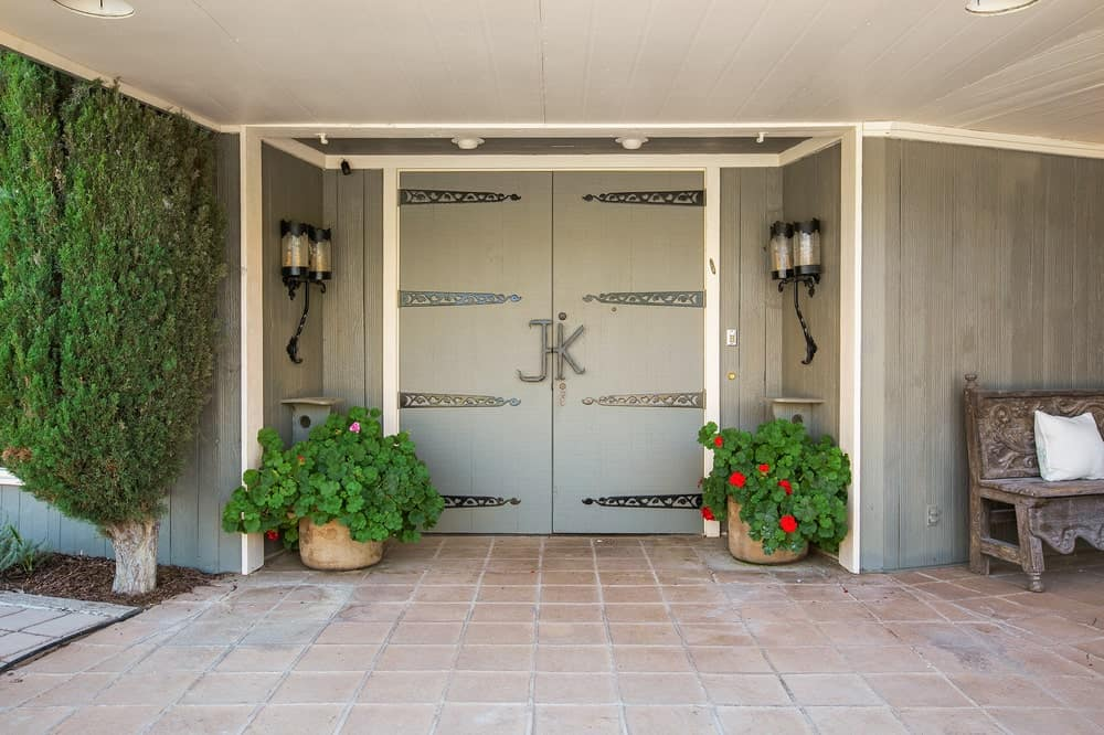 This is the main door of the Founder's Building adorned with potted plants and wall lamps that bring color to the gray tones. Image courtesy of Toptenrealestatedeals.com.