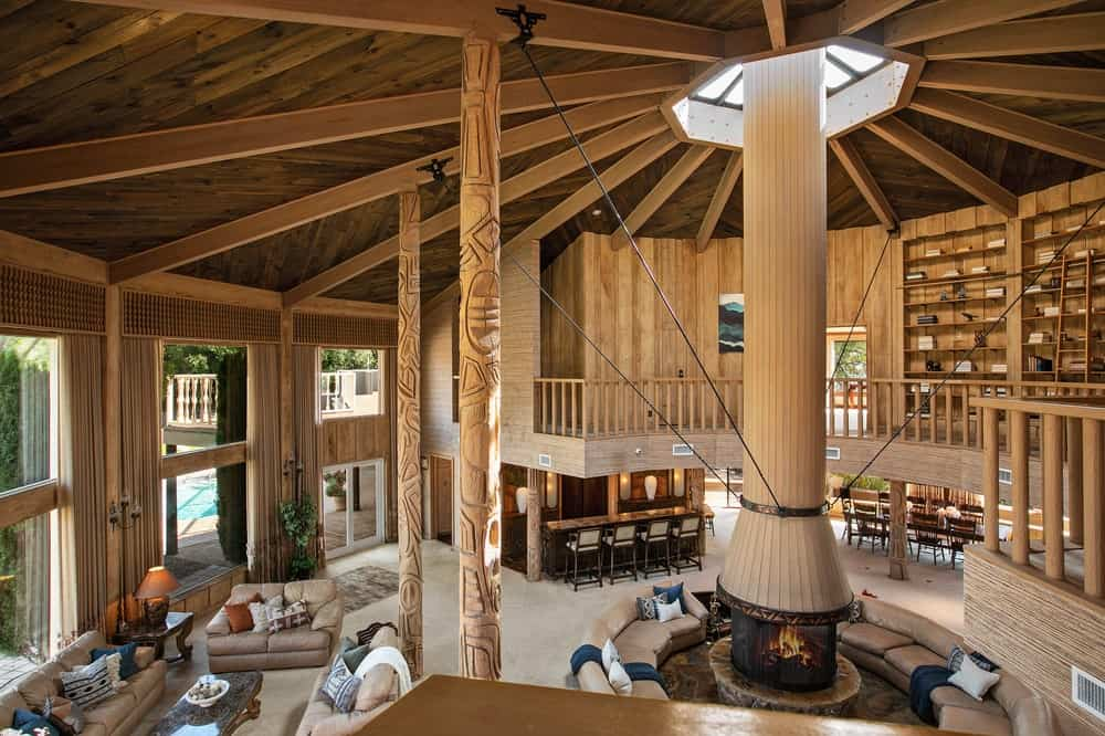 This is the view of the massive hall and living room area from the vantage of the indoor balcony. You can also see here the tall beamed ceiling. Image courtesy of Toptenrealestatedeals.com.