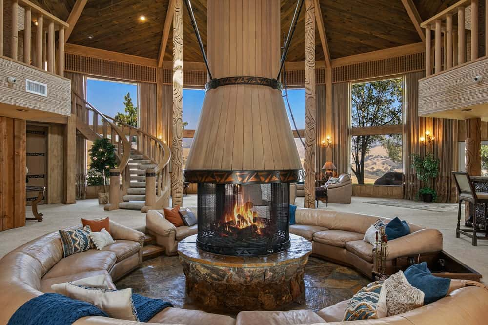 This is a close look at the conversation pit in the middle of the large hall with a fireplace in the middle. Image courtesy of Toptenrealestatedeals.com.