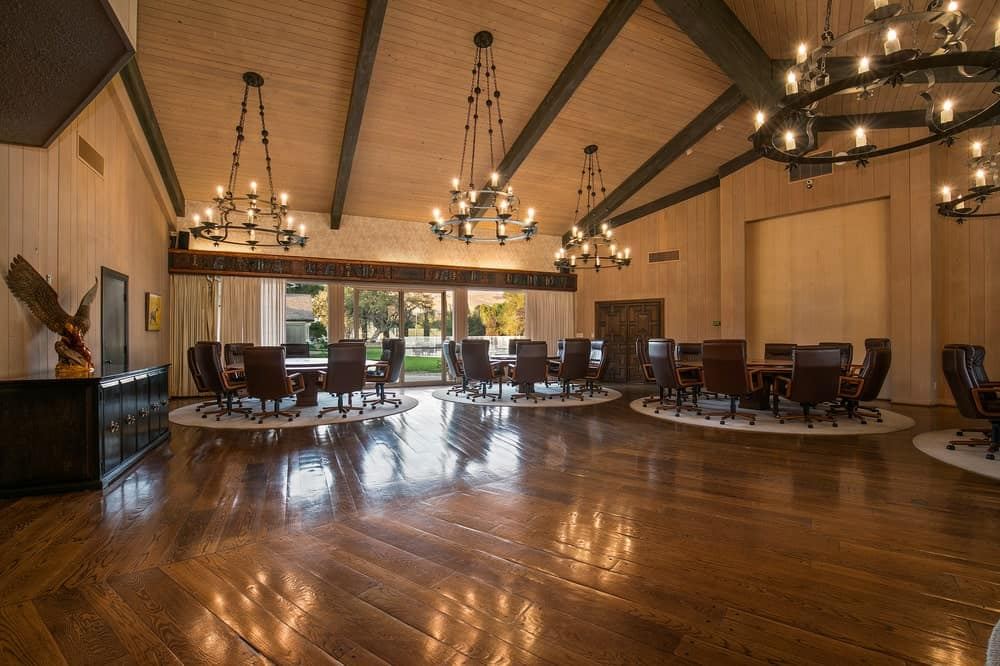 This is the massive dining area with dining sets, chandeliers and a spacious hardwood flooring. Image courtesy of Toptenrealestatedeals.com.